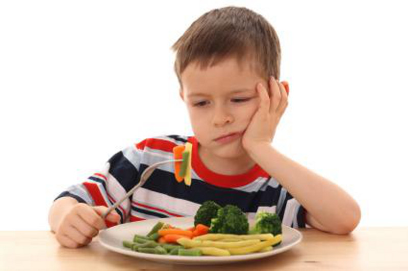 Boy Eating Veggies